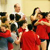 WARREN DILLAWAY / Star Beacon<br /> EDGEWOOD SWIMMERS celebrate after the lady Warriors won the Ashtabula County Invitational on Saturday at Spire Institute in Harpersfield Township.