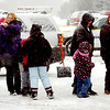WARREN DILLAWAY / Star Beacon<br /> VISITORS TO Winterfest 2013 wait in line for chili on Saturday in downtown Geneva.