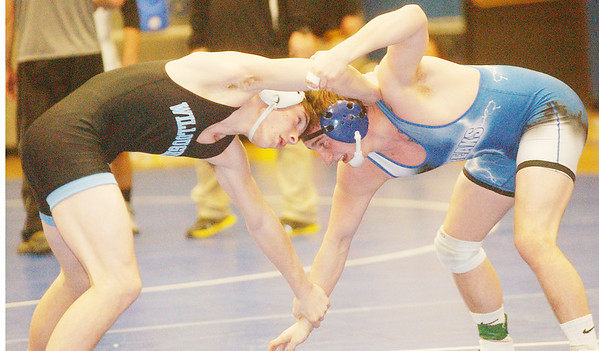 WARREN DILLAWAY / Star Beacon<br /> TIM STREISEL of Madison (right) wrestles Mike Mousar of Willoughby South during a 170 pound bout on Saturday during the PAC wrestling meet at Madison.