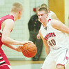 WARREN DILLAWAY / Star Beacon<br /> ANDREW KONCZAL (40) of Edgewood defends Caley Burdyshaw of Perry on Friday night at Edgewood.