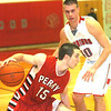 WARREN DILLAWAY / Star Beacon<br /> ANTHONY KEIPERT (15) of Perry drives to the basket with Edgewood's Andrew Konczal (40) defending on Friday at Edgewood.