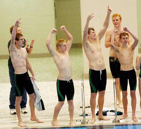 WARREN DILLAWAY / Star Beacon<br /> LAKESIDE SWIMMERS celebrate after the boy Dragons won the Ashtabula County Invitational on Saturday at Spire Institute in Harpersfield Township.