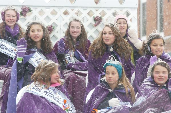 WARREN DILLAWAY / Star Beacon<br /> GENEVA GRAPE JAMBOREE royalty try stay warm during the Winterfest Parade Saturday in Geneva.