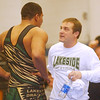 WARREN DILLAWAY / Star Beacon<br /> CHUCK MORGAN of Lakeside confers with his coach Jerry Brady on Saturday aftern he won the 285 pound PAC wrestlig match at Madison.