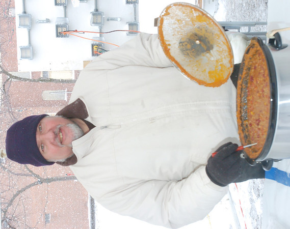WARREN DILLAWAY / Star Beacon<br /> NICK MATKO of Pittsburgh came all the way to Geneva to test his chili against area competitors at the Winterfest Chili Cook Off Saturday in Geneva.