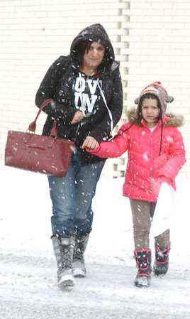 WARREN DILLAWAY / Star Beacon<br /> MORGAN AMATO and her daugher Savannah, both of Austinburg, brave snowy weather to attend the Winterfest in Genva on Saturday.