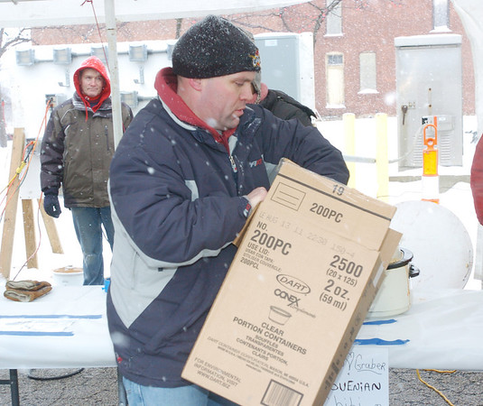WARREN DILLAWAY / Star Beacon<br /> MIKE GODDARD, of the Geneva Area Business Association, displays supplies Saturday afternoon at the organization's Winterfest celebration.