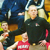 WARREN DILLAWAY / Star Beacon<br /> AL IACOFANO, Perry boys basketball coach, watches the action Friday night at Edgewood.