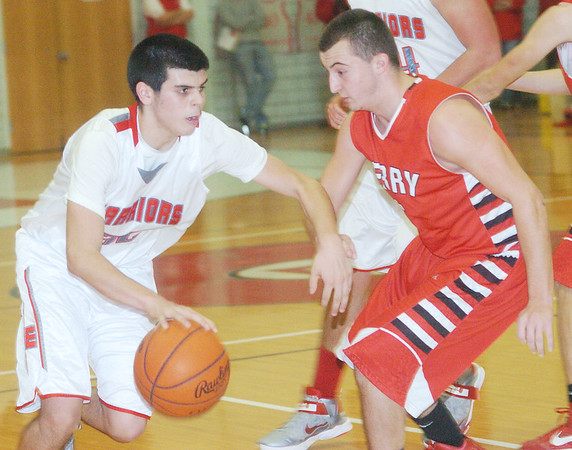 WARREN DILLAWAY / Star Beacon<br /> DANIEL JOSLIN (with ball) of Edgewood drives to the basket as Perry's ryan Bellissimo defends on Friday night at Edgewood.