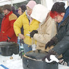 WARREN DILLAWAY / Star Beacon<br /> SANDRA KOREN (far right) participates in the Winterfest Chili Cook Off Saturday in Geneva. She shared the tent  with 13 other competitors.