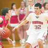 WARREN DILLAWAY / Star Beacon<br /> ALEX WISNYAI (32) of Edgewood defends Perry's Ian Illig on Friday night at Edgewood.
