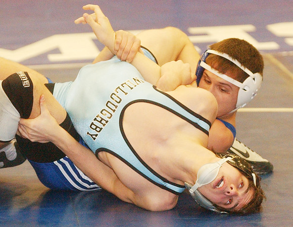 WARREN DILLAWAY / Star Beacon<br /> RYAN MONTGOMERY (back) of Madison wrestles Matt Moyseenko of Willoughby South on Saturday during the PAC wrestling meet at Madison.