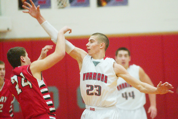 WARREN DILLAWAY / Star Beacon<br /> LOU WISNYAI (23) of Edgewood follows through on an attempted blocked shot by Perry Mike Sorine on Friday at Edgewood.