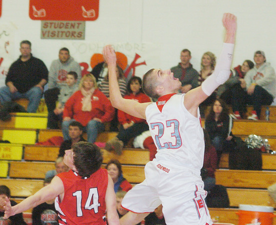 WARREN DILLAWAY / Star Beacon<br /> LOU WISNYAI (23) of Edgewood and Perry's Ian Illig (14) of Perry watch the ball after Wisnyai's twisting layup on Friday evening at Edgewood.