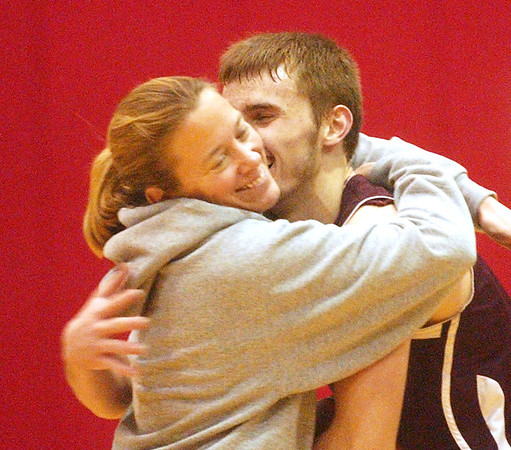 WARREN DILLAWAY / Star Beacon<br /> TIM CROSS of Pymatuning Valley is congratulated by Laker athletic director Mel Noakowski after Cross scored his 1,000th point from the free throw line on Tuesday evening at Geneva.