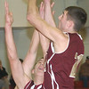 WARREN DILLAWAY / Star Beacon<br /> QUINTIN RATLIFF (right) of Pymatuning Valley and Laker teammate Chase Thurber (44) leap for the ball on Tuesday night at Geneva.