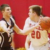 WARREN DILLAWAY / Star Beacon<br /> QUINTIN RATLIFF (left) of Pymatuning Valley defends Vern Thompson of Geneva during a Tuesday night game at Geneva.