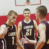 WARREN DILLAWAY / Star Beacon<br /> QUINTIN RATLIFF (21) is all smiles as Pymatuning Valley teammate Tim Cross (1) is congratulated by Laker Grant Nowakowski (12) on Tuesday night after Cross scored his 1,000th career point at Geneva.
