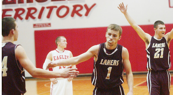 WARREN DILLAWAY / Star Beacon<br /> TIM CROSS of Pymatuning Valley is congratulated by teammate Chase Thurber (left) while Laker Quintin Ratliff (21) celebrates after Cross scored his 1,000th point from the free throw line on Tuesday evening at Geneva.
