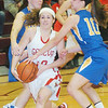 WARREN DILLAWAY / Star Beacon<br /> SARAH DEPP (with ball) of Geneva drives by Jillian Miller of Notre Dame Cathedral Latin on Thursday night during Division II sectional action at Pymatuning Valley.