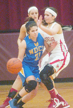 WARREN DILLAWAY / Star Beacon<br /> EMILY BALL (right) of Geneva defends Amy Carr (with ball) of Notre Dame Cathredral Latin during Division II sectional finals action at Pymatuning Valley Thursday night with Lyndsey Armstrong in the background.