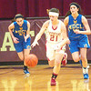 WARREN DILLAWAY / Star Beacon<br /> BECKY DEPP of Geneva (21) runs the floor with McKinzie Trotta (left) and Jillian Miller, both of Notre Dame Cathedral Latin, following the play on Thursday during Division II sectional final action at Pymatuning Valley.