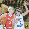 WARREN DILLAWAY / Star Beacon<br /> BRITTANY LEVKULICH (3) of Perry drives to the basket with Calli Schmitt (10) of Cortland Lakeview on Thursday during Division II sectional final action at Pymatuning Valley.