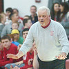 WARREN DILLAWAY / Star Beacon<br /> JOHN BOWLER, Edgewood boys basketball coach, tries to calm his team down the stretch Friday night at Jefferson.