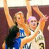 WARREN DILLAWAY / Star Beacon<br /> KELSEA BROWN (3) of Pymatuning Valley passes to a teammate while Kelly Preske of Grand Valley (10) defends on Monday in Andover Township.