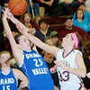 WARREN DILLAWAY / Star Beacon<br /> MICHAELIA SKLERES (33) of Pymatuning Valley fouls Grand Valley's Kayla Sellitto (23) of Grand Valley on Monday evening at Pymatuning Valley.
