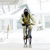 WARREN DILLAWAY / Star Beacon<br /> DEREK JOHNSON of Orwell uses a mask to stay warm while riding his bicycle along Route 322 in Orwell Monday afternoon.
