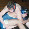 WARREN DILLAWAY / Star Beacon<br /> LAITH ALANI (right) of Conneaut holds on tight to the leg of Jefferson's Blake Perry during a 182 pound match on Tuesday at Conneaut.
