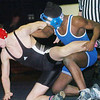WARREN DILLAWAY / Star Beacon<br /> TROY STITT of Jefferson (left) attempts to escape the grasp of Jeleel Portis of Collinwood on Tuesday at Conneaut.
