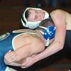 WARREN DILLAWAY / Star Beacon<br /> AUSTIN SHERMAN (top) of Conneaut wrestles Zach Collins of Jefferson during a 152 pound match at Conneaut.