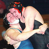 WARREN DILLAWAY / Star Beacon<br /> BILLY POST (left) of Conneaut and Daniel Gillespie of Jefferson battle it out during a 220 pound match at <br /> Conneaut Tuesday night.