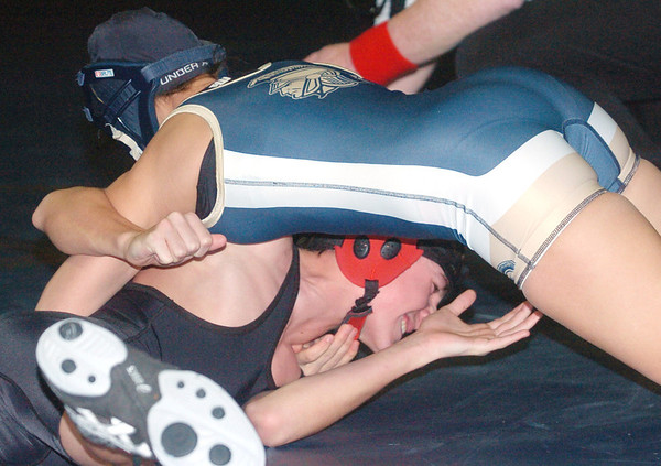 WARREN DILLAWAY / Star Beacon<br /> ALESHA ZAPPITELLA of Conneaut (top) pinned Victor Toth of Jefferson during a 113 pound bout on Tuesday night at Conneaut.