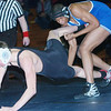 WARREN DILLAWAY / Star Beacon<br /> ZACH COLLINS (left) of Jefferson tries to escape from Damera Daniels of Collinwood during a 152 pound match on Tuesday night at Conneaut.