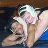 WARREN DILLAWAY / Star Beacon<br /> ZACH COLLINS (right top) of Jefferson controls Damera Daniels during a 152 pound match on Tuesday night at Conneaut.