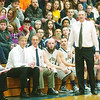 WARREN DILLAWAY / Star Beacon<br /> TIM TALLBACKA, Conneaut boys basketball coach, (standing), his assistants Bill Isco (left seated) and Tom Ritari, players Bud Ritari (beard) and Christian Williams and a portion of the Conneaut crowd watch the action during a home game with Edgewood Friday night.
