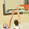 WARREN DILALWAY / Star Beacon<br /> ZACH OSCAR (24)  of Grand Valley tries to block a shot by Chase Thurber of Pymatuning Valley on Friday night at Pymatuning Valley.