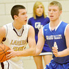 WARREN DILLAWAY / Star Beacon<br /> CHASE THURBER of Pymatuning Valley prepares to pass while defended by Jake Vormelker of Grand Valley on Friday night in Andover Township.