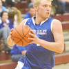WARREN DILLAWAY / Star Beacon<br /> JAKE VORMELKER of Grand Valley drives to the basket on Friday in Pymatuning Valley.