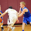 WARREN DILLAWAY / Star Beacon<br /> JAKE VORMELKER (right) of Grand Valley defends Quintin Ratliff (21) of Pymatuning Valley on Friday night in Andover Township.