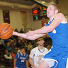 WARREN DILLAWAY / Star Beacon<br /> JAKE VORMELKER of Grand Valley (4) drives to the basket in front of Quintin Ratliff of Pymatuning Valley on Friday night at Pymatuning Valley.