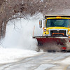 WARREN DILLAWAY / Star Beacon<br /> GENEVA TOWNSHP crews work Lake Road near Geneva State Park on Tuesday afternoon.