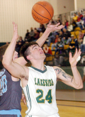 WARREN DILLAWAY / Star Beacon<br /> KYLE DOWNS of Lakeside (24) drives to the basket in front of Jeff Nevulis of Willoughby South on Friday night at Lakeside.
