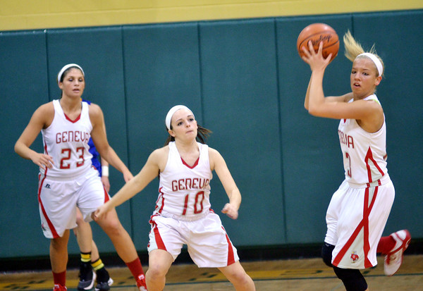 WARREN DILLAWAY / Star Beacon<br /> LINDSEY MAYLE (with ball) makes a steal as Geneva teammates Rachael Harrington (10) and Sarah Juncker watch the play on  Monday evening during Division II District Semifinal action at Lakeside.