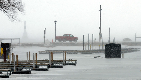 WARREN DILLAWAY / Star Beacon<br /> SNOW SQUALLS hit Conneaut Harbor on Monday afternoon.