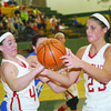 WARREN DILLAWAY / Star Beacon<br /> GENEVA TEAMMATES Annaliesa Fistek (left) and Sarah Juncker reach for the ball on Monday evening durig a Division II District Semifinal game at Lakeside.