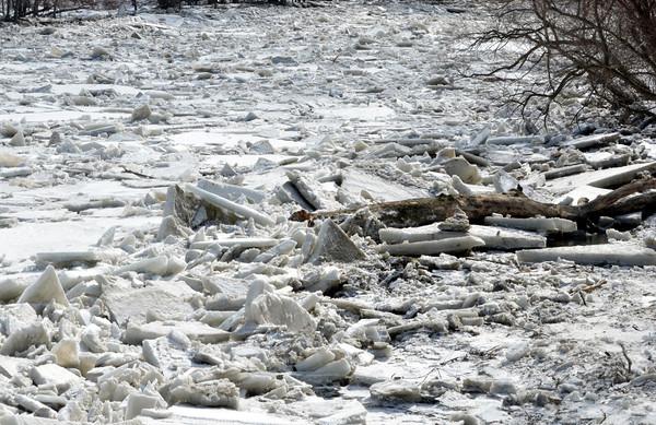 WARREN DILLAWAY / Star Beacon<br /> ICE JAMS the Ashtabula River near the Ashtabula County Mecical  Center on Monday.